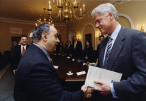 Photo of ACCESS Executive Director Ahmed shaking hands with Bill Clinton