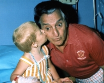 Photo of Lebanese American entertainer, Danny Thomas with one of the young patie